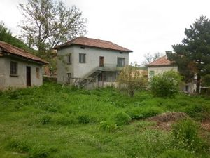 Old rural house with plot of land and summer kitchen located in a village near mountains and forest