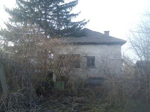 An old rural house located near small river in a village