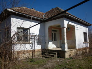 Small rural house with big yard located in a lively village