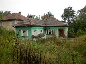 Old rural house with plot of land located next to big river