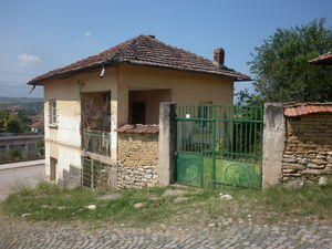 Old country house with summer kitchen and land in a village