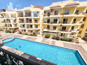 2 bedroom apartment in a residential compound with a pool