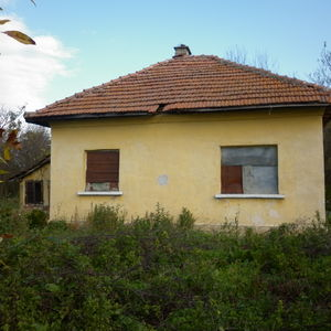 Old country house with plot of land located in small village