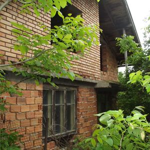 Old rural house with spacious yard located in quiet village