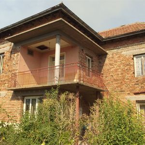 Spacious house with storage building and big yard in village